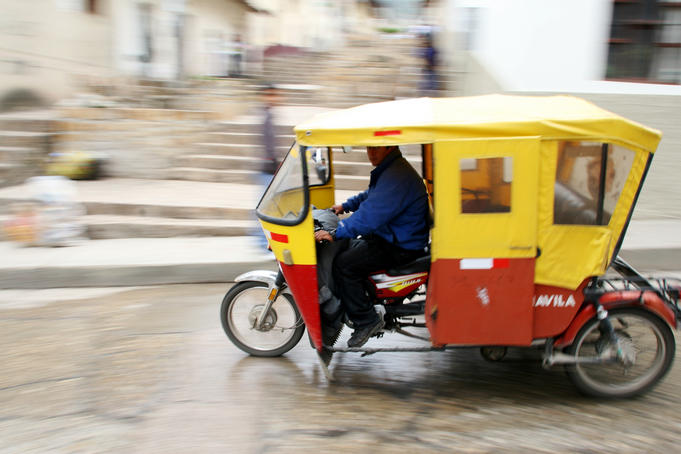 Mototaxi driving in the city center, Cajamarca