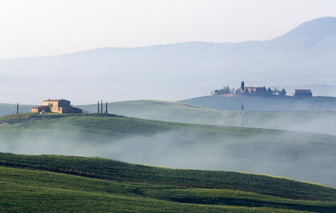 Fog over hills of Val d'Orcia.