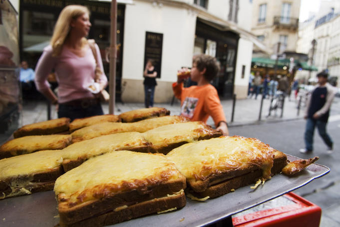 Croques (toasted cheese sandwiches) for sale on street in Place St-Germain des Bres area.