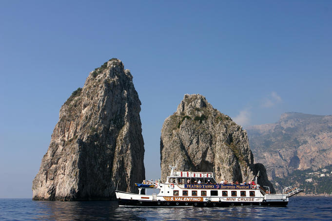 Ferry sailing past I Faraglioni, Island of Capri.