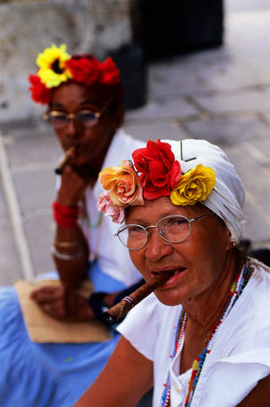 Portrait of cigar-smoking Cuban woman in Plaza de Armas.