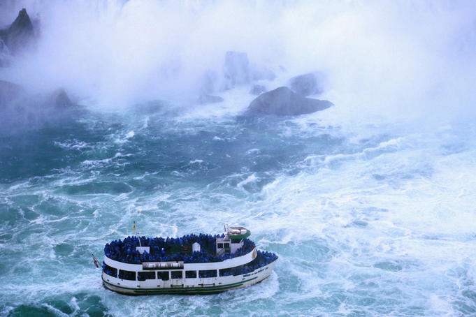 'Maid of the Mist' taking tourists for a wet ride in the spray of Horseshoe Falls, largest of the Niagara Falls.