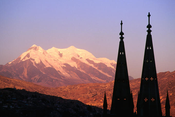 Illimani at sunset, with silhouetted spires.