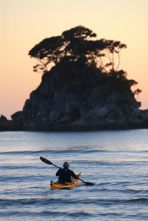 Kayaking at sunrise, Torrent Bay.