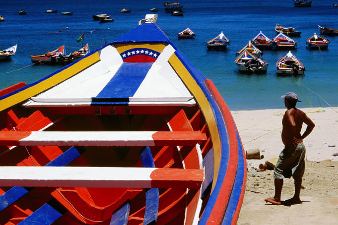 Brightly-painted boats on Playa Manzanillo.