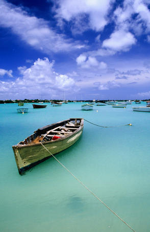 Fishing boats anchored in lagoon.