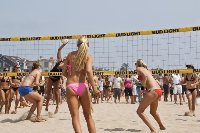 Women's beach volleyball team in action at the Manhattan Beach Surf Festival Volleyball Tournament.