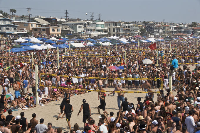... spectators at the Manhattan Beach Surf Festival Volleyball Tournament
