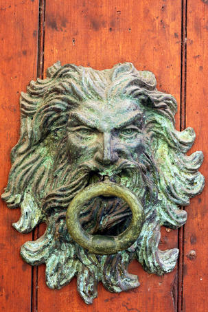 Large door knocker in the walled city.