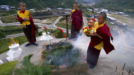 Buddhist monks making smoke, Bhutan