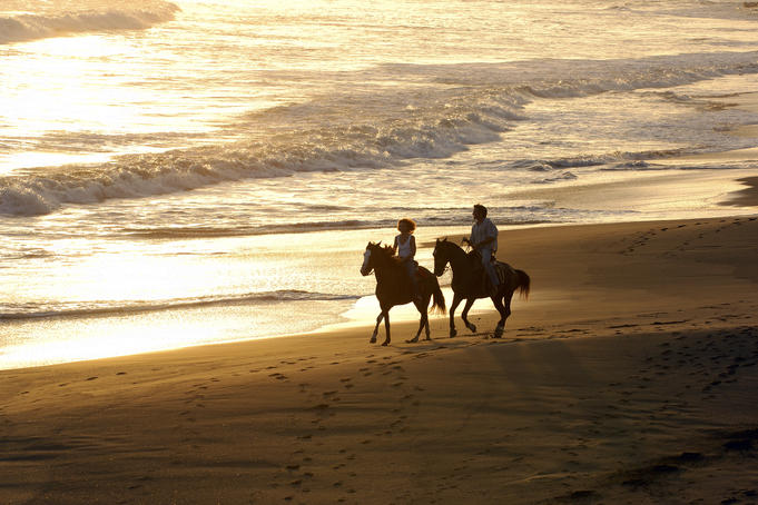 Couple horse-riding on Playa Los Destiladeros (beach).