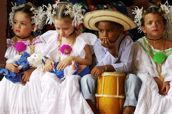Children wearing Pollera national dress at La Mejorana music festival.