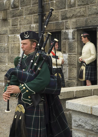 Costumed interpreters and a bagpipe player, Halifax Citadel National Historic Site.