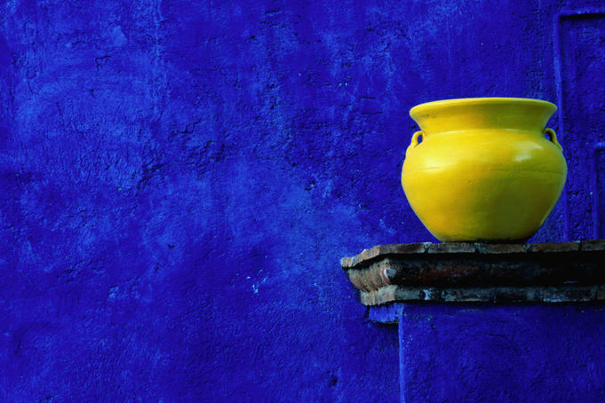 Yellow pot and blue wall.