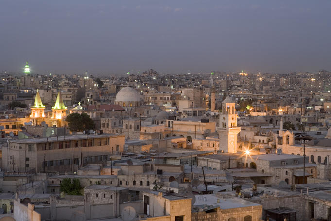 Overhead view of Aleppo city skyline at dusk from rooftop of Sheraton Aleppo Hotel.