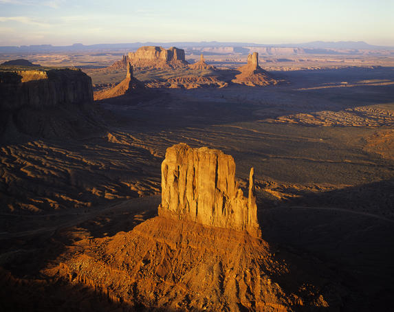 Aerial overlook of West Mitten Butte in Monument Valley at sunset.