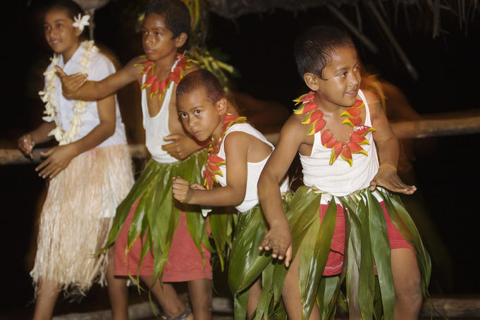 Children dancing at a Tongan feast on 'Ene'io Beach.