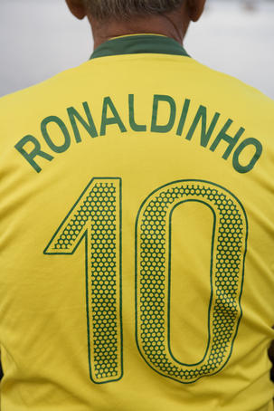 Back view of man wearing number 10 Ronaldinho Brazilian national soccer team football jersey.