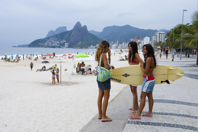 Young female surfers, Ipanema beach.
