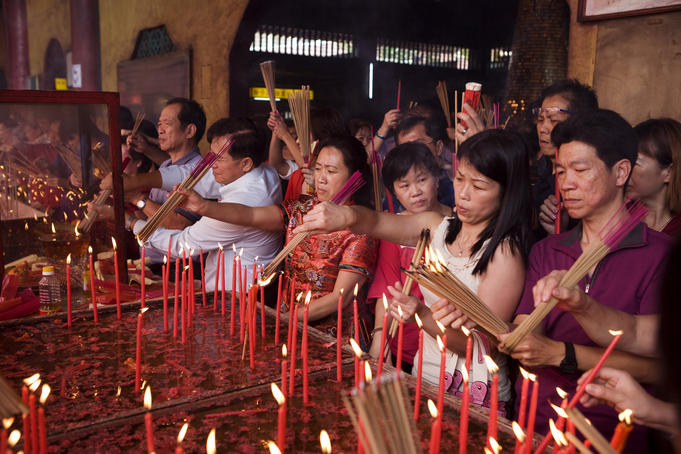 Devotees lighting incense at Lian Shan Shuang Lin Monastery also known as Siong Lim Temple.