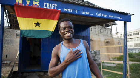Eric outside NYB Craft stall, Ghana
