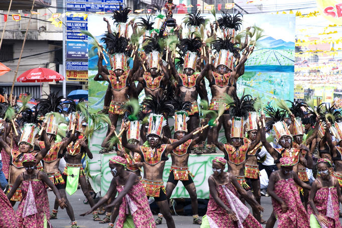 Dance group performing at Dinagyang Festival street parade.
