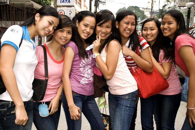 Group of teenage girls posing for the camera.