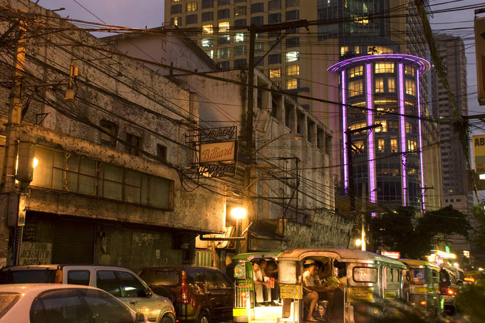 Hilton Hotel, old buildings and jeepneys along M H del Pilar Street, Ermita district.