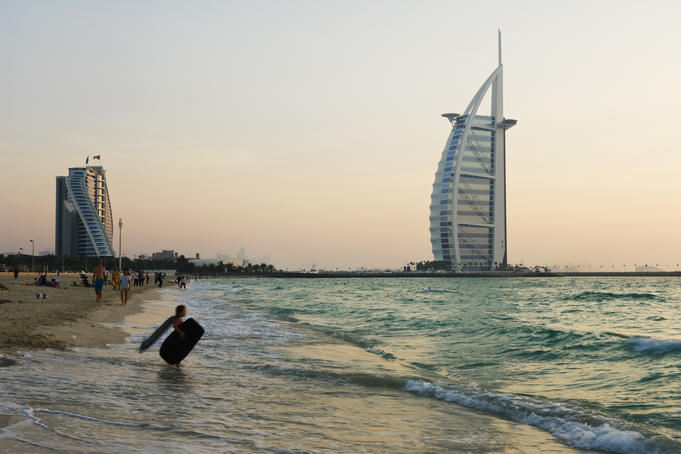 Dubai beach with Burj al-Arab hotel (right), standing on an artificial island out from Jumeirah beach, in background.