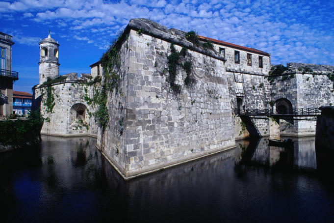 The stone walls of the Castillo Real de la Fuerza dip into a moat, in Colonial Havana