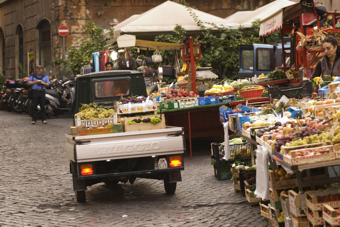 Fruit and vegetable stalls and small Piaggio truck at open market, Piazza di Trevi.