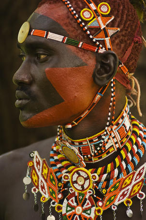 Side profile of highly decorated Samburu Warrior.