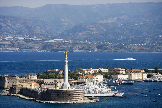 Madonnina del Porto statue and Coast Guard station in Port of Messina.