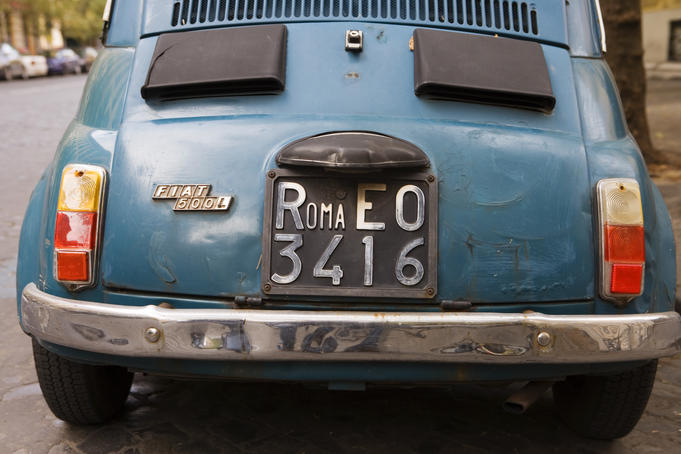 Detail of Roma license plate on old Fiat 500L car.