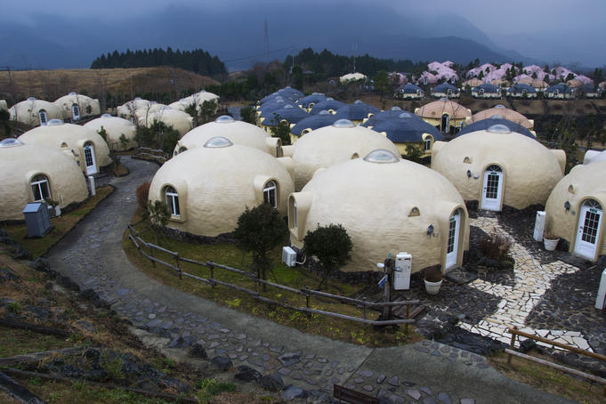 Lots of small round hotel-houses of Farmland Village health resort.