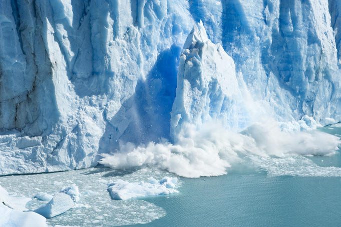 Ice calving off Glacier Perito Moreno. This wall is about 200 feet high, the same as a 20-story office building.