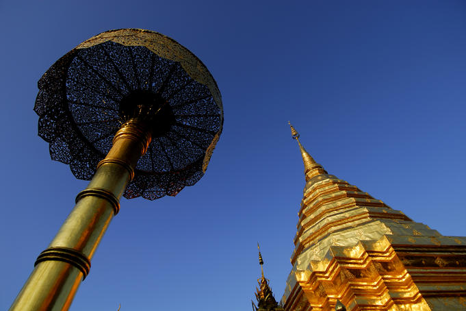 Umbrella and gilded stupa spire at Wat Phra That Doi Suthep temple.