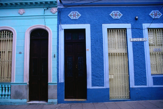Doors in the colourful blue buildings of Santa Clara near the city centre