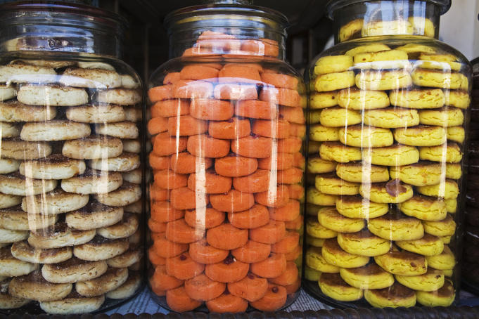 Glass jars with cookies in Kumily market.