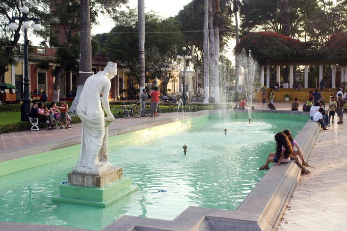 Girls playing by fountain, Barranco.