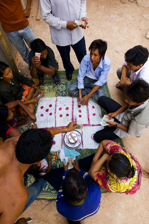 Group of people gambling.