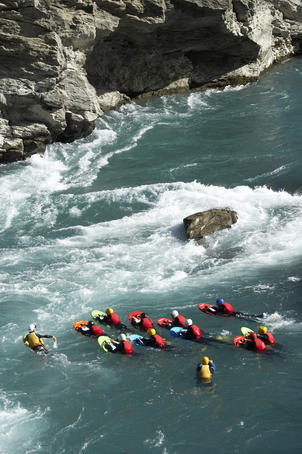 River surfing on the Kawarau River, Kawarau Gorge at Roaring Meg.