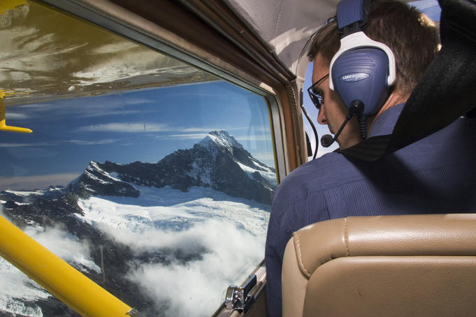 Cockpit of small plane over Milford Sound.