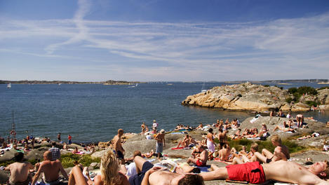 Sprawled on rocks, Sweden