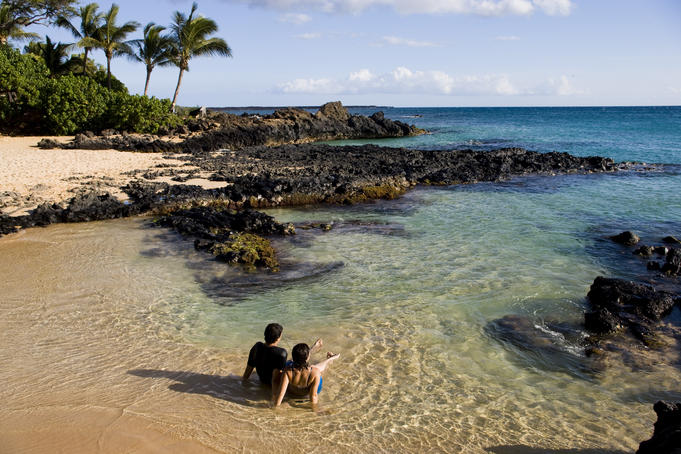 Bathing in the shallows at Secret Cove, South Maui.