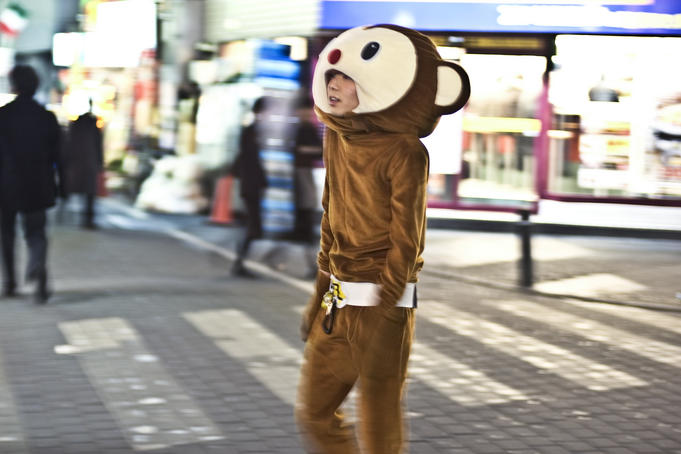 Promoter in animal costume on street crossing, Ikebukuro district.