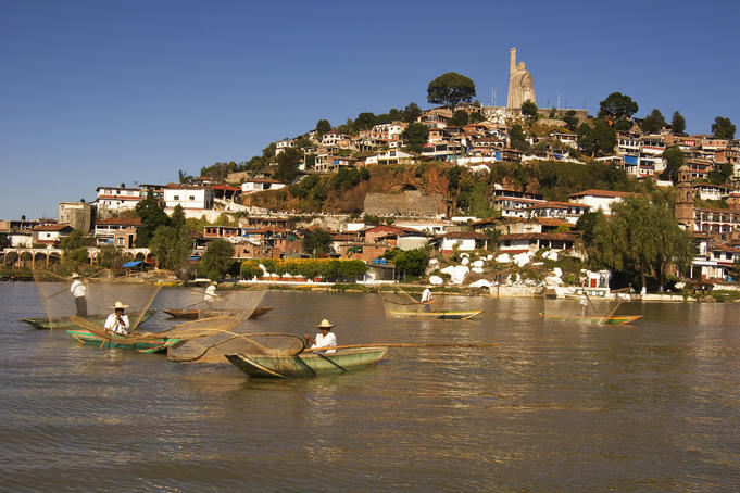 Fishermen with butterfly (mariposa) nets on Lago Patzcuaro in front of Isla Janitzio.