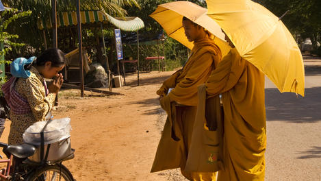 woman, alms to monks, Siem Reap