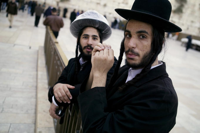 Jewish men gathering before their most sacred shrine, the Western Wall.