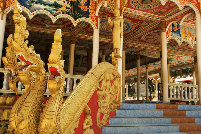 Gold nagas at the entrance to a Buddhist monastery.